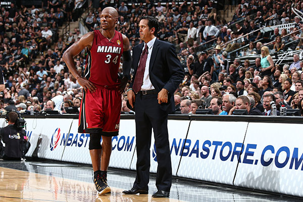 Coach Spo talks to Ray Allen on the sidelines.